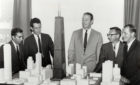 Faz Kahn, Bruce Graham, William Brown, and others look at a model of the John Hancock Center